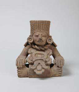 Early Classic (Monte Albán III-A), Zapotec Anthropomorphic urn ('companion' type), A.D. 250–500 Gray clay, brown on surface, very micaceous h. 18.2 cm., w. 16.7 cm., d. 15.7 cm. (7 3/16 x 6 9/16 x 6 3/16 in.) Museum purchase, gift of Sally Sample Aall y1968-236