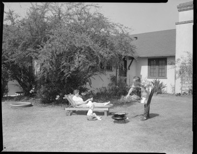 Family barbecuing in backyard Joseph Fadler 1957