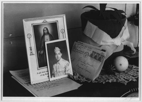 Ansel Adams. Manzanar Relocation Center, California. Pictures and mementoes on phonograph top: Yonemitsu home.