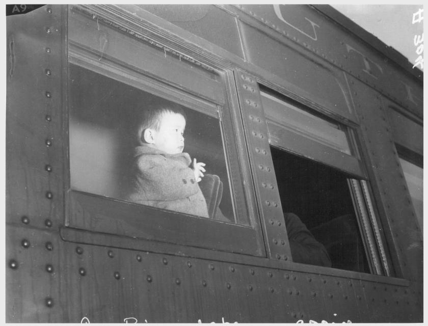 Clem Albers. Lone Pine, California. 4/1/42. A young evacuee of Japanese ancestry arrives here by train prior to being transferred by bus to Manzanar, now a War Relocation Authority center.