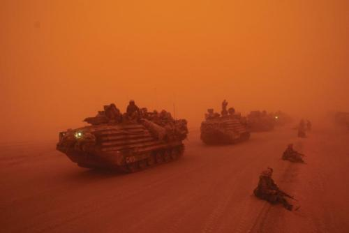 FILE -- A severe sandstorm blanketed a convoy from the Headquarters Battalion of the 1st Marine Division north of the Euphrates River in Iraq, on March 25, 2003. President Barack Obama announced Oct. 21, 2011, that the United States had fulfilled its commitment in Iraq and would bring all U.S. troops home by the end of the year. Ozier Muhammad/The New York Times