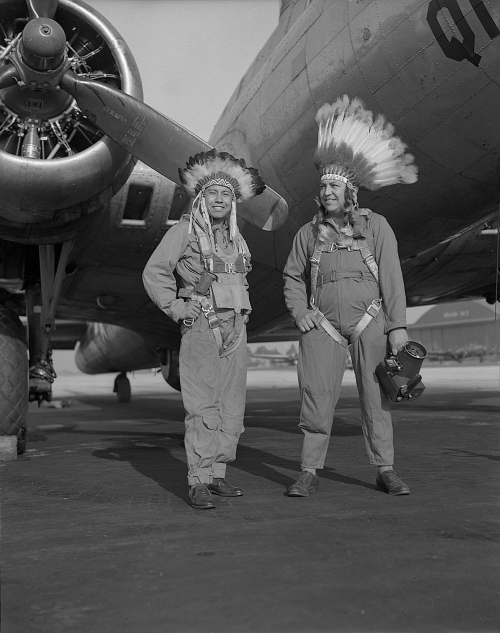 Gus Palmer (Kiowa, at left), side gunner, and Horace Poolaw (Kiowa), aerial photographer, in front of a B-17 Flying Fortress. MacDill Field, Tampa, Florida, ca. 1944. 45UFL14 © 2014 Estate of Horace Poolaw