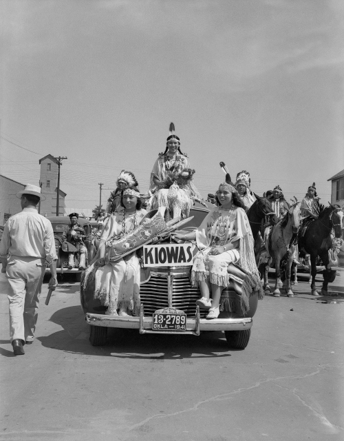 Left to right: Juanita Daugomah Ahtone (Kiowa), Evalou Ware Russell (center), Kiowa Tribal Princess, and Augustine Campbell Barsh (Kiowa) in the American Indian Exposition parade. Anadarko, Oklahoma, 1941. © 2014 Estate of Horace Poolaw