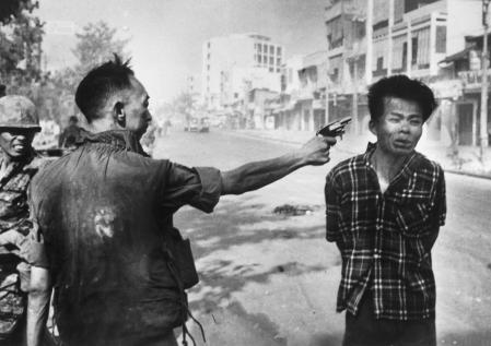 South Vietnam National Police Chief Nguyen Ngoc Loan executes suspected Viet Cong member Nguyen Van Lem. Eddie Adams.