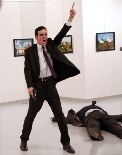 Mevlut Mert Altintas standing over Andrei Karlov, the Russian ambassador to Turkey. Burhan Ozbilici, The Associated Press.