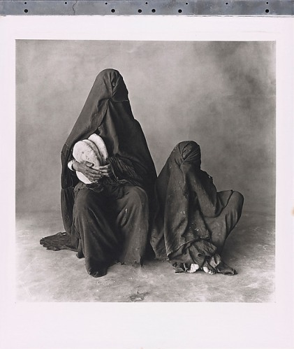 Irving Penn. Two Women in Black with Bread, Morocco.