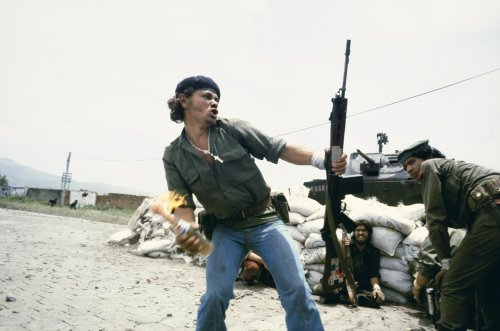 "Susan Meiselas. Sandinistas at the walls of the Estelí National Guard headquarters, ""Molotov Man,"" Estelí, Nicaragua, July 16, 1979."