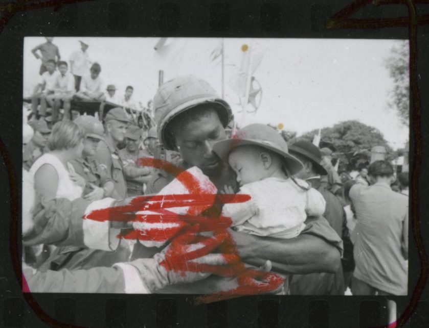 Spc. 5th Class Jimmy L. Arnold with a village child on Christmas Day, 1965. Photo: Ann Bryan, Hoover Library & Archive