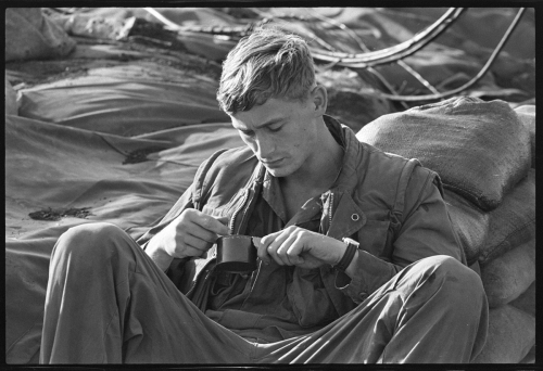 An unidentified soldier examines his C ration meal on May 3, 1969. Photo: OW Staffer, Hoover Library & Archive